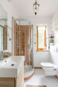 Modern bathroom with orange shower tiles