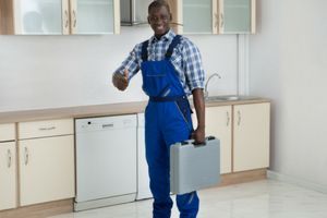 plumber holding a tool box